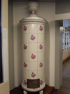 Hungarian wood burning stove made with Herend porcelain tiles - a really beautiful example.
