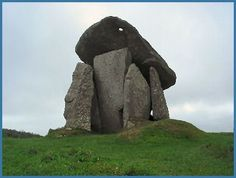 Trevethy Quoit, also known as King Arthur's Quoit, is one of the more impressive burial chambers in Cornwall. Standing at over 15 feet, dates from the Bronze Age period. The capstone is pierced by a hole, the purpose of which is unknown. A small portion of the front entrance stone is also missing, it has been surmised that this was cut to leave an entrance into the chamber. The whole structure may at one time have been covered with a mound of earth long since degraded by the changing seasons. Legend Of King, King Arthur Legend, Ancient Mysteries, Stonehenge, Ancient Aliens, Bronze Age, Prehistory, British Isles, Cornwall
