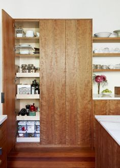 Cherry wood pantry with pullout shelves.