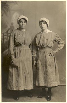 Two munitions workers from Edinburgh, 1914 - 1918.  During the First World War (1914 - 1918), many factories had to convert from peacetime to wartime production, and to recruit women as their workforce. The uniform worn by these women developed in response to the need for practical and safe clothing.