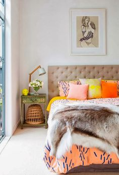We love the pop of color in the pillows. #home #decor