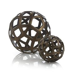 Geo Balls | Crate and Barrel.  To go on bookshelf, to break up all the books.