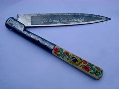 """ratak-monodosico:  Corsican vendetta knife with floral detail. The blade reads: """"Che la mia ferita sia mortale""""  - or roughly: """"may all your wounds be mortal""""."""
