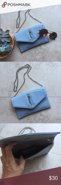 """HOT PICK  Danielle Nicolle clutch wallet . Light blue clutch wallet with long metal string in case you want to use as cross body bag.  Like new only used one time. Size 7.5"""" x 5"""" Danielle Nicole Bags Clutches & Wristlets"""