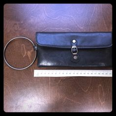 NWOT Victoria's Secret Black Clutch NWOT Victoria's Secret Black Clutch with Pink lining. Metal ring that always you to wear around your wrist. Great for date night! See pic for measurements Victoria's Secret Bags Clutches & Wristlets