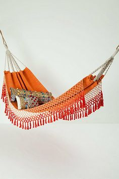 Kick back and enjoy some R in this rustic style beach chic of a hammock.  This all cotton orange hammock flaunts a flirty smocked fringe! Gotta have it for $98 from anthropologie.com and it comes in other colors!