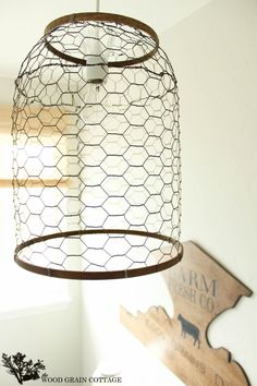 Farmhouse Light with Chicken Wire by The Wood Grain Cottage from http://www.thewoodgraincottage.com/2013/09/05/laundry-room-farmhouse-light/