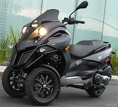 Piaggio's three wheeled MP3 scooter! Why, yes, I will take one in Black and Neon Green!:)