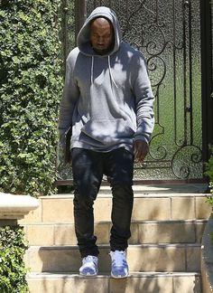 Kanye West wearing Nike Flyknit+