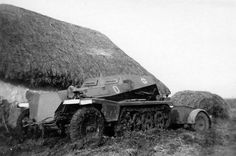 A SdKfz 252 ammunition supply halftrack with amo trailer