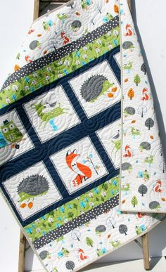 """Ready to ship! Fun forest animals like deer, fox, hedgehogs, and owls all adorn this whimsy quilt. The colors are nice and modern navy blue, grey, green, and orange. You can choose the size baby (38""""x45"""") or toddler (38""""x54""""). This would make a perfect blanket for the little one in your life! Modern and trendy with a fun forest woodland theme! QUILTERS: We have a QUILT KIT here. A quilt is three layers stitched together, with the middle layer being a natural cotton batting. Professionally…"""