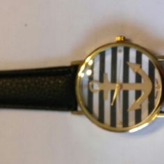 Black leather look blue white striped anchor watch This is a brand new watch I never used.The stem is pulled out so the battery is fresh.It is 6.50-8 inches with adjustable band Pamela May Collection Accessories Watches