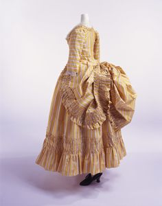 """Robe à la polonaise, ca 1780 France, KCI  Fashionable men and women of the late rococo era loved all things rustic. Their version of rustic, anyway. A popular form of portraiture in this era was the pastoral portrait, where the female sitter was dressed as a """"shepherdess"""" who looked like she had never worked a day in her life. Likewise, the polonaise was an idealized imitation of """"rustic"""" country dress. Working women would tuck their skirt up through their pockets to k"""