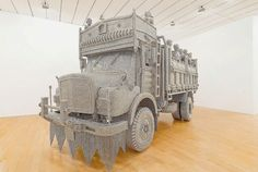 An Ornate Truck Spot-Welded from Thousands of Reflective Steel Disks by Valay Shende
