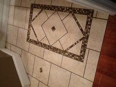 "LOVE my new bathroom floor! Inlaid tile ""rug"" design. Perfect pattern & colors!"