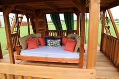Daybed Swing can be built under a fort or porch.perfect place to unwind after a long day! Redwood Daybed swing installed under a massive Fort Ticonderoga playset. Playground Design, Backyard Playground, Backyard For Kids, Groundhog Day, Garden Day Bed, Cool Playgrounds, Backyard Playset, Outdoor Daybed, Outdoor Play Spaces