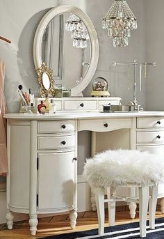 elegant, old-fashioned, yet the clean white color, the chandelier, and the fur keep it modern