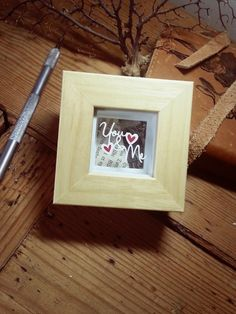 'You and Me' - Original Miniature Papercut - his tiny little sentiment is hand cut from a single sheet of cream textured paper. The cut features a tiny red filled love hearts. Suspended over a vintage book page. A perfect example of teeny tiny papercutting, that casts beautiful shadows inside the frame.