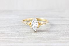 Marquise white sapphire and diamond engagement ring in gold or