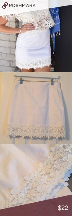 J Crew white skirt with floral detail The cutest white skirt ever! Worn to my bridal shower, has a couple of spots that I haven't tried to get out, but I'm sure a little bleach will do the trick!  The skirt is fitted, 17 inches long, fully lined and so cute on! J. Crew Skirts Mini
