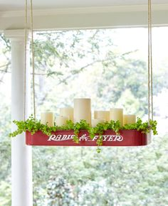 DIY a cute and charming hanging luminary to decorate your porch by removing the wheels from a little red wagon and looping rope through the hooks.