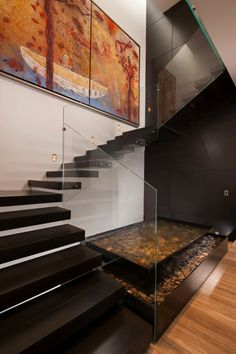 #Home  #Apartment Black Oak Staircase Separated By Glass Beside Painting Art Work And Internal Natural Aquarium Above Wooden Floor In Luxury Residence Of CH House By GLR Arquitectos Attractive Luxury Residence in Mexico Offering High Quality Lifestyle by GLR Arquitectos