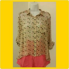 Camel print sheer high/low button down -mauve color background with multi-colored camel print -size M -21 inch length in front  -31 inch length in back -20 inch bust -option to cuff sleeve or roll and button on arm -25 inch arm length  -mis-hemmed in small area inside shirt (pic above) -100% polyester, sheer -some loose threads at hem and pulls on shirt -very good condition Kanvas Tops Button Down Shirts
