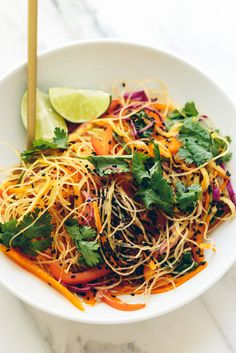 Perhaps it's the appealing rainbow hues or the tangy dressing that coats it. Or maybe it's the irresistible crunch of fresh peppers, cabbage, and carrots.