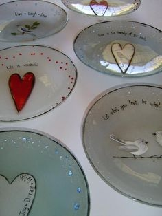 M Beneke fused glass heart plates