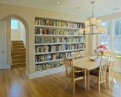 My friend, architect Neal A. Pann, came up with this clever dining room/library scheme. LOVE.