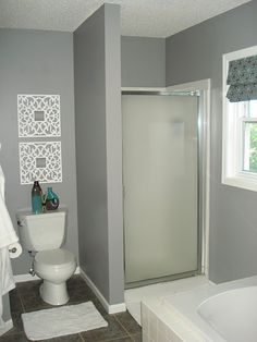 Glidden Granite Gray Bathroom, Wall EXACTLY what we're lookkng for. Except need dark vanity Hangings, Curtain. Home, House Styles, Grey Walls, Boys Bathroom, Grey Bathrooms, Bathroom Wall Hanging, Upstairs Bathrooms, Grey Paint, Gray Bathroom Walls