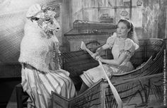 """Lewis Carroll's """"Alice In Wonderland"""", the book that is one of Britain's national treasures comes to the stage at the Scala Theatre, London. Alice, played by actress Roma Beaumont, in a scene from """"Through The Looking Glass"""", where the Sheep, played by Phyllis Morris gives Alice a pair of knitting needles and they turn into oars in her hand. (Photo by Kurt Hutton/Picture Post/Getty Images). 15th January 1944"""