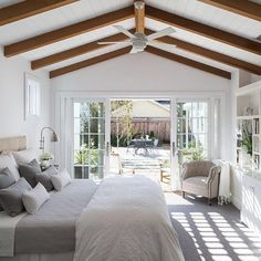 A soothing and soft bedroom full of light. Designer tip: Hang ...