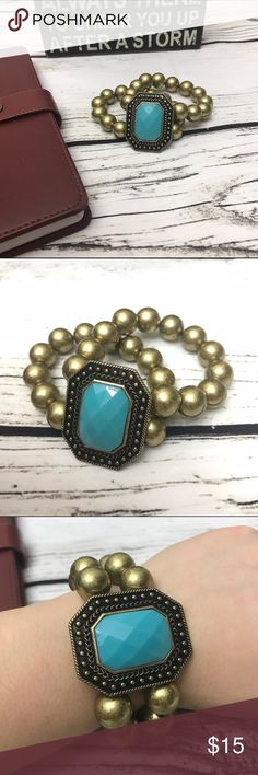 Rustic Gold Beaded Turquoise Statement Bracelet Rustic Gold Beaded Turquoise Statement Bracelet - soooo cute to go with any Boho outfit - a total must! Double beaded strands on stretchy string with a large rustic and vintage turquoise embellishment! Jewelry Bracelets