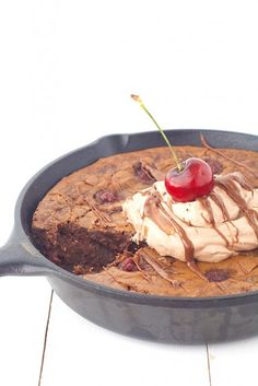 Dig into this deep dish Black Forest Skillet Brownie filled with cherries and topped with chocolate whipped cream.