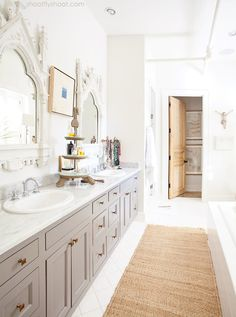 Love the grey vanity, with white marble floors & counters.  Atchison Home | White Bathroom | Gray Vanity | Antique Mirrors
