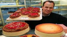 Must make! Ate here while walking around the theater district in NYC. This cheesecake is YUM-O-LICIOUS!!!! (Alan Rosen, co-owner of Juniors Restaurant, holds a tray of strawberry cheesecakes, NYC.)