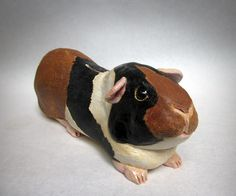 Paco is a beach-loving surfer cavy and the newest addition to the Griffith Tso Guinea Piggy Bank collection. Piggy Banks, Sculpting, Beach, Collection, Whittling, Sculpture, The Beach, Money Bank, Sculptures