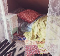 My lace tent and bed covered in printed blankets