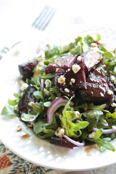 Roasted Beet and Arugula Salad with Raspberry Balsamic Dressing
