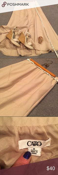 Creamy tan Cato skirt Beige/ light kaki/ creamy tan color. Unique stitching design. Medium/heavy weight ladies lined skirt has nice full swing and swish. Wear with boots this fall and sandals next spring. Like new condition. Cato Skirts