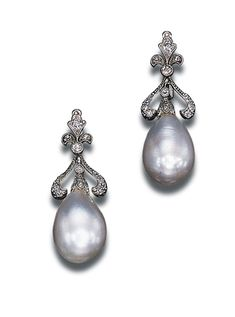 A PAIR OF ANTIQUE PEARL AND DIAMOND EAR-PENDANTS Each set with a baroque drop-shaped pearl measuring approximately 9.20 - 10.65 x 15.60 and 9.40 - 10.50 x 14.65 mm. to the diamond-set fleur-de-lis top, circa 1910 With certificate 35417 dated 29/3/2000 from the SSEF Swiss Gemmological Institute stating that the pearls are natural