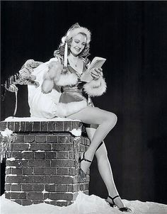 Vintage Lovely Santa on Chimney Pin Up Beauty!  Is that a stuffed dog hanging on to her Toy Sack??  Huh?