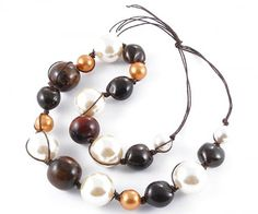 - Necklace with 6 beads, ivory resin cm.3 diameter, 6 seeds of ebony ku kui tree resin beads 6 cm in diameter. Ocher and pink 2, 3 horn beads of different diameters