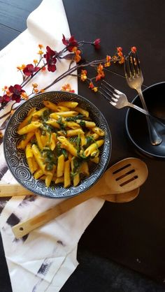 Pumpkin Coconut Cream Pasta with Spinach  Saute:2c fresh spinach  1T olive oil 1 t red pepper flakes  1 t garlic powder  1 t onion powder  1/2 t black pepper  For 2 to 3 minutes. Add 2c cooked penne, toss. Remove from skillet, set aside. In that skillet make your cream sauce.  Cream Sauce: 1 c vegetable stock 1 c coconut milk  Reduce together about 10 minutes. Add 1/2 c pumpkin  Reduce 10 to 15 minutes until thick and creamy. Combine with the pasta Season with 1 t Himalayan sea salt