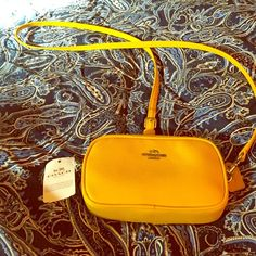 NWT: Coach Crossbody Beautiful yellow coach crossbody with double zippers and keychain on the side. Coach Bags Crossbody Bags