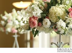 Gorgeous ivory and blush floral arrangements.   Florist: An Added Touch http://www.anaddedtouchflowers.com/index2.html