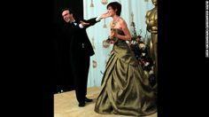 """Actor Roberto Benigni presents Hilary Swank, who won the best actress Oscar for the film """"Boys Don't Cry."""""""