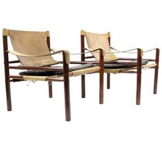 Two Rosewood Sirocco Chairs by Arne Norell | From a unique collection of antique and modern armchairs at https://www.1stdibs.com/furniture/seating/armchairs/