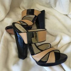 LAMB leather high sandals Beautiful condition tan and black leather sandals, Selling for a friend, she bought the heels here and she decided to delete her account  The sandals are the exact same size but for some reason one is tagged at size 8 and the other sandal is size 7.5??? weird! see additional pictures please. L.A.M.B. Shoes Sandals